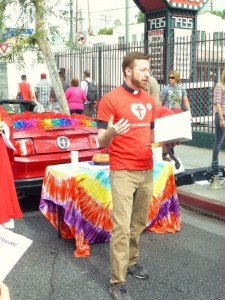 Rev. Caleb Crainer leading worship at Los Angeles Pride.