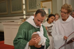 The newly ordained Rev. Javen Swanson presiding at his first baptism.