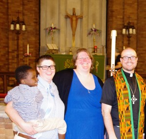 Catherine Swanson (middle) and family with Pastor Erik Christensen.
